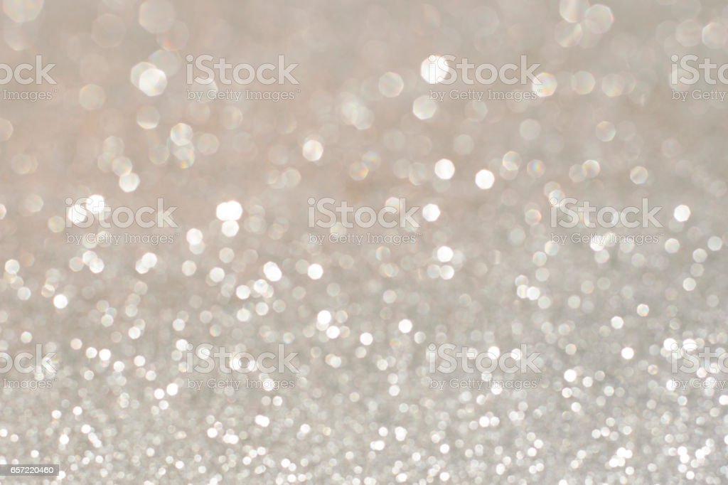 Silver glittering christmas lights. Blurred abstract holiday background stock photo