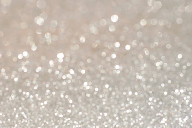 Silver glittering christmas lights. Blurred abstract holiday background - Photo