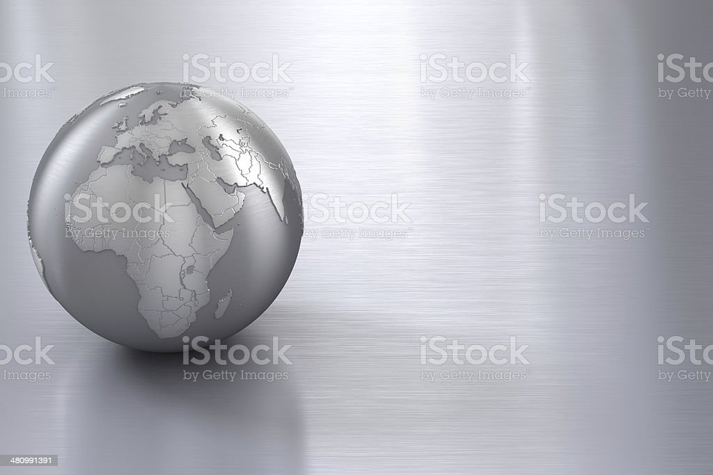 Silver globe on stainless steel with copy space stock photo