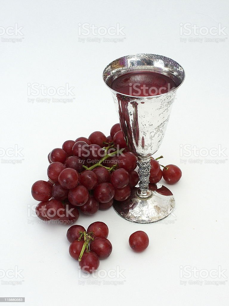 Silver goblet of wine and grapes stock photo