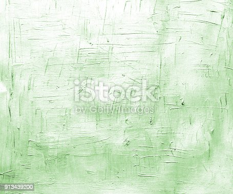 istock Silver green painted canvas with brush strokes. Metallic effect background for card or banner template 913439200