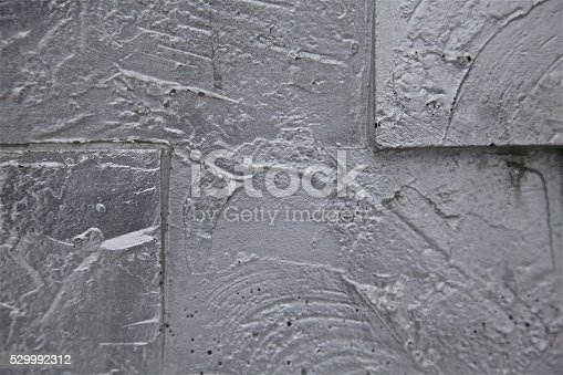 1084390994istockphoto silver grey background patterns over urban city concrete wall 529992312