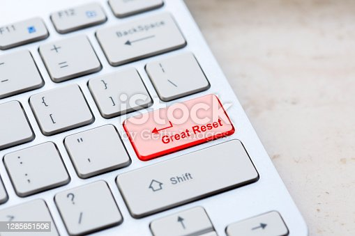 istock Silver grey keyboard close up with world global great reset enter- button 1285651506