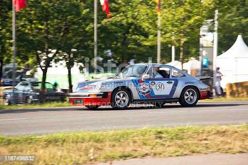Jüchen, Germany - August 2019. A 1974 silver grey Porsche 911 GT4  on the race tracks around Schloss Dyck castle during the Classic Days in Jüchen, Germany.