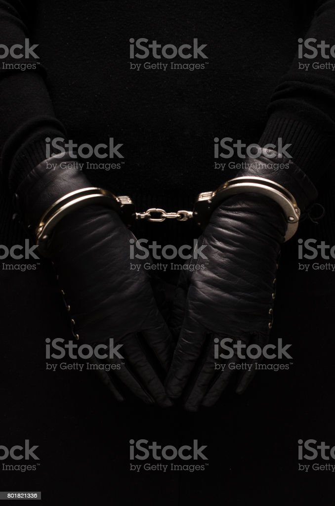Silver handcuffs leather black gloves, concept Silver handcuffs leather black gloves, concept Arrest Stock Photo