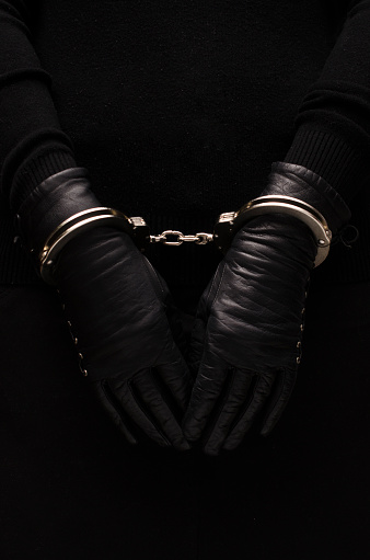 Silver Handcuffs Leather Black Gloves Concept Stock Photo - Download Image Now