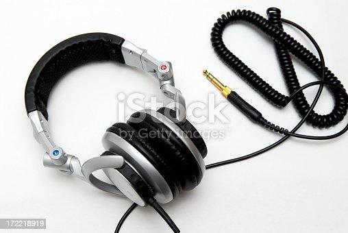 A set of silver DJ headphones.