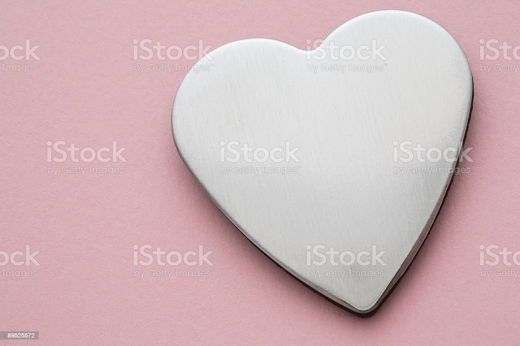 Silver Heart on Pink Background royalty-free stock photo