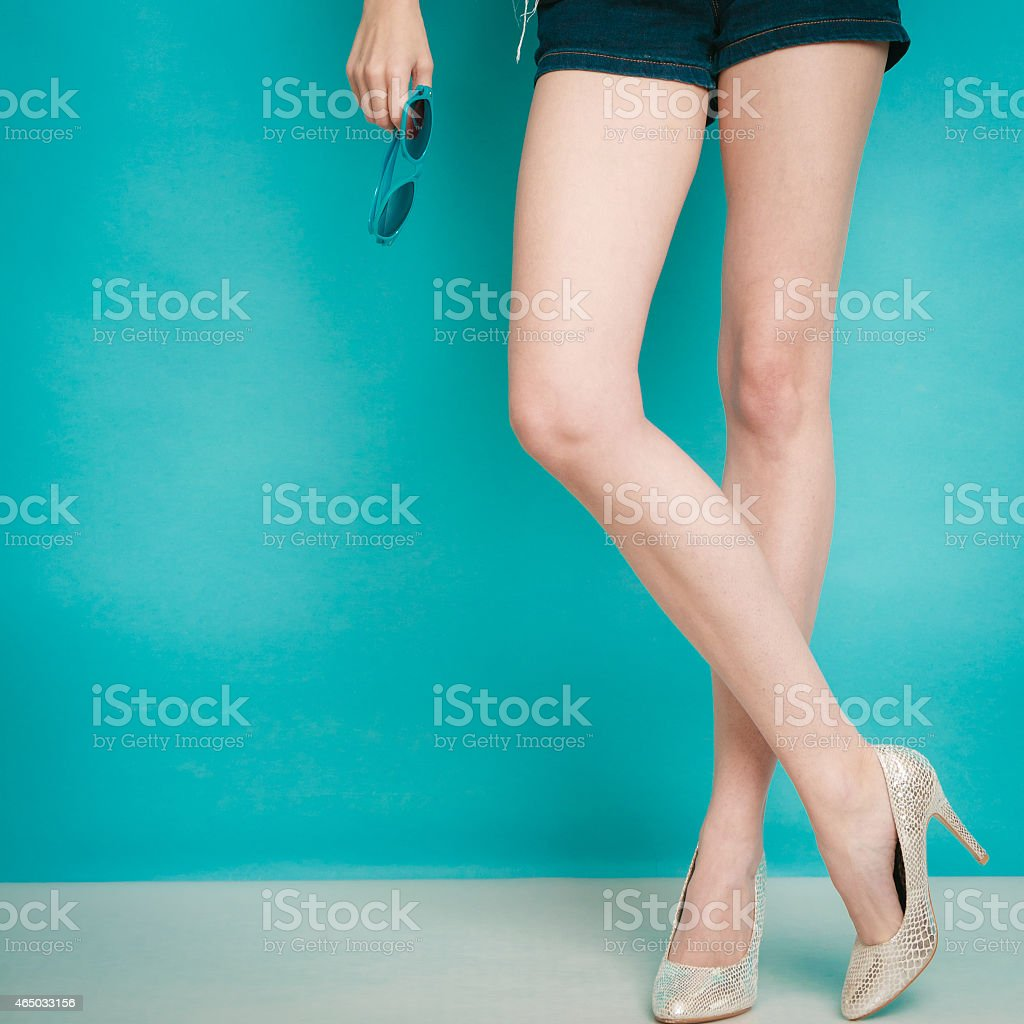 silver high heels fashionable shoes on sexy female legs stock photo