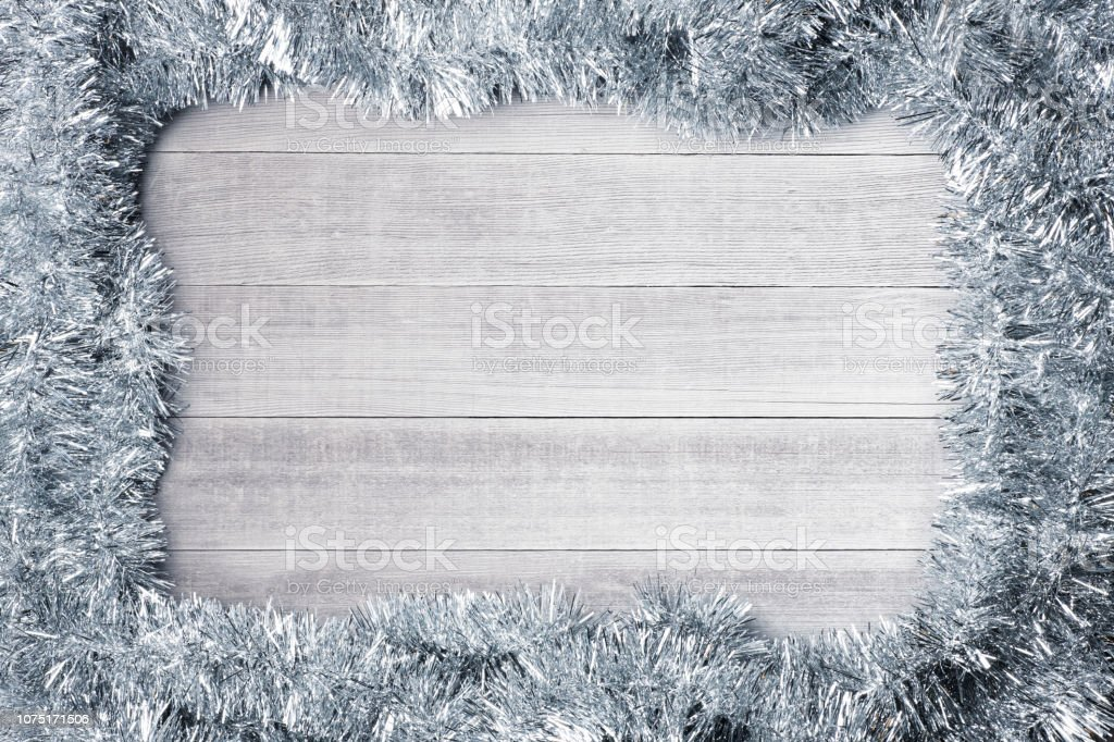 Silver Holiday Garland On Whitewashed Wooden Planks stock photo