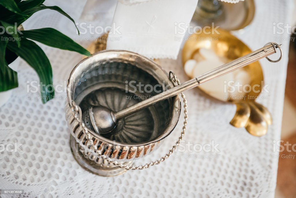 Silver holy water bucket stock photo