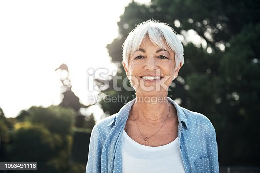 Portrait of a happy senior woman enjoying a day in the park
