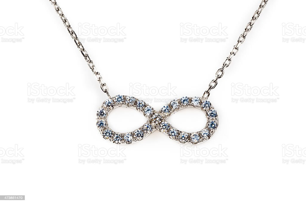 Silver infinity pendant with diamond stock photo