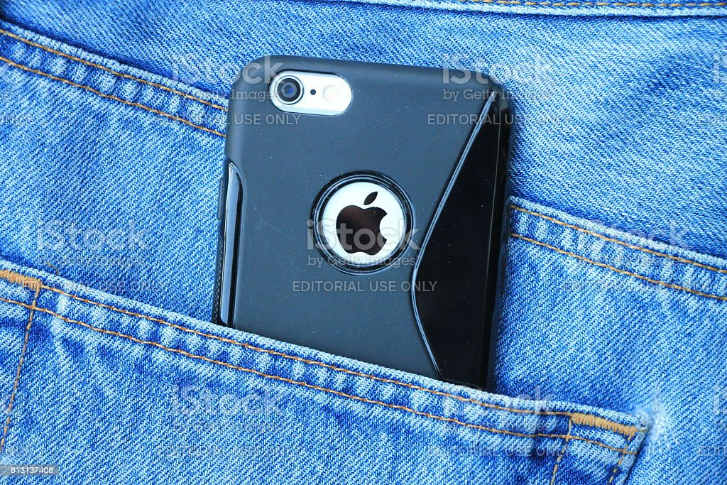 Silver iPhone 6 with black case in jeans pocket stock photo