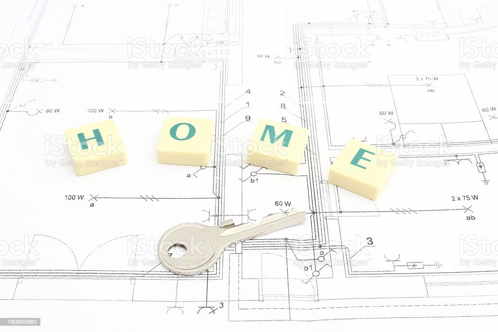 Silver key and word home on the housing plan royalty-free stock photo