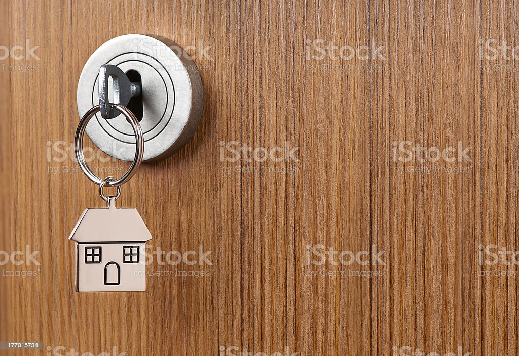 Silver Key in the brown door stock photo