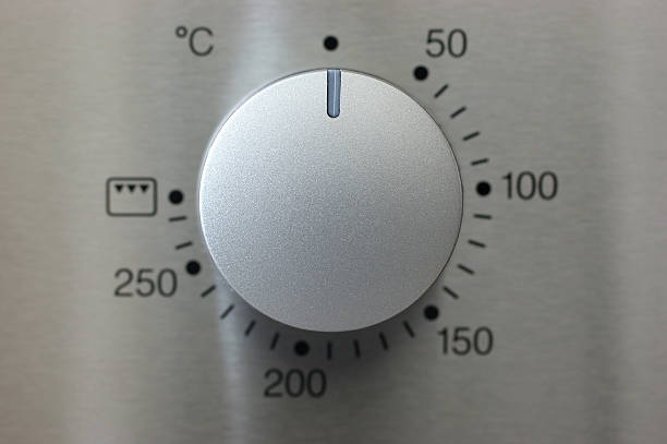 silver knob a silver knob of a oven taken with macro lens knob stock pictures, royalty-free photos & images