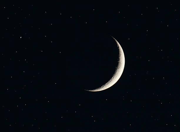Silver last quarter moon and black sky stock photo