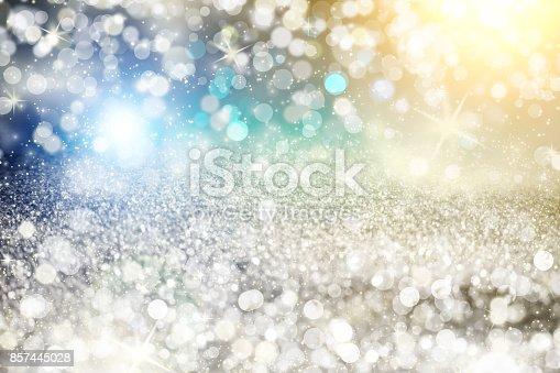 istock Silver light bokeh background. Abstract grey shiny glitter bokeh christmas background 857445028