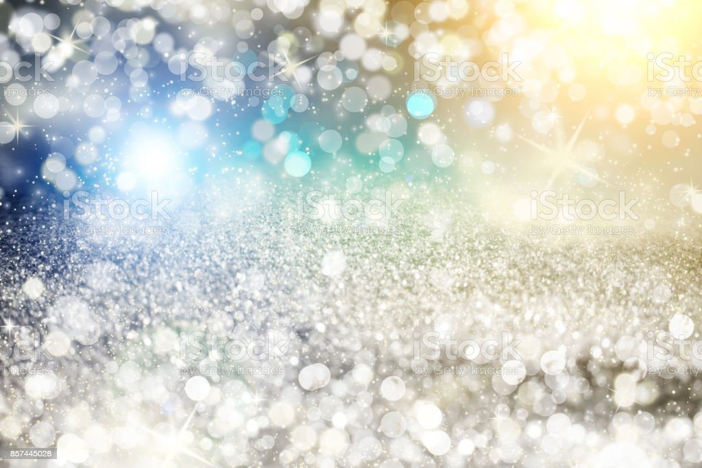 Silver light bokeh background. Abstract grey shiny glitter bokeh christmas background stock photo