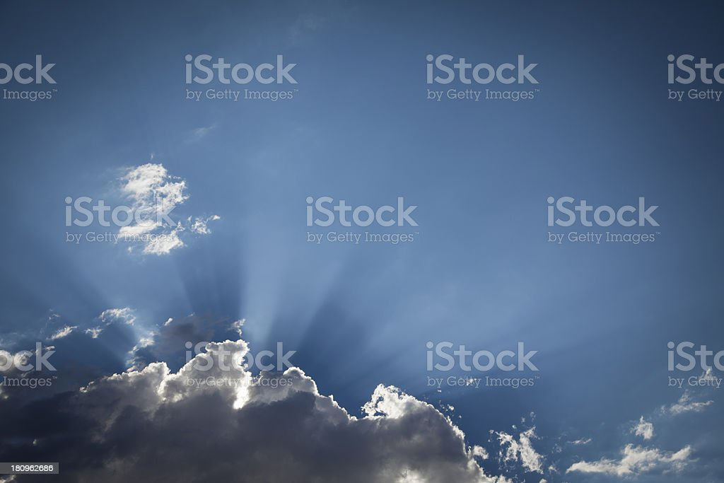 Silver Lined Storm Clouds with Light Rays and Copy Space royalty-free stock photo