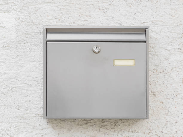 A silver mailbox on the wall stock photo