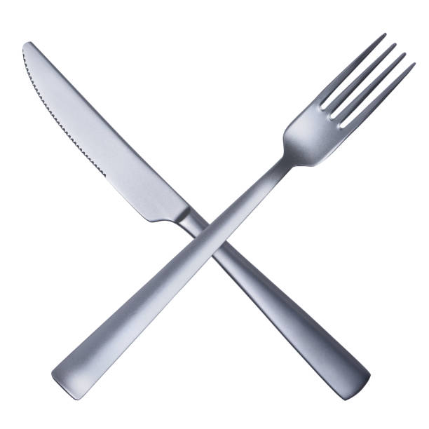 silver matted metal knife and fork crossed - table knife stock photos and pictures