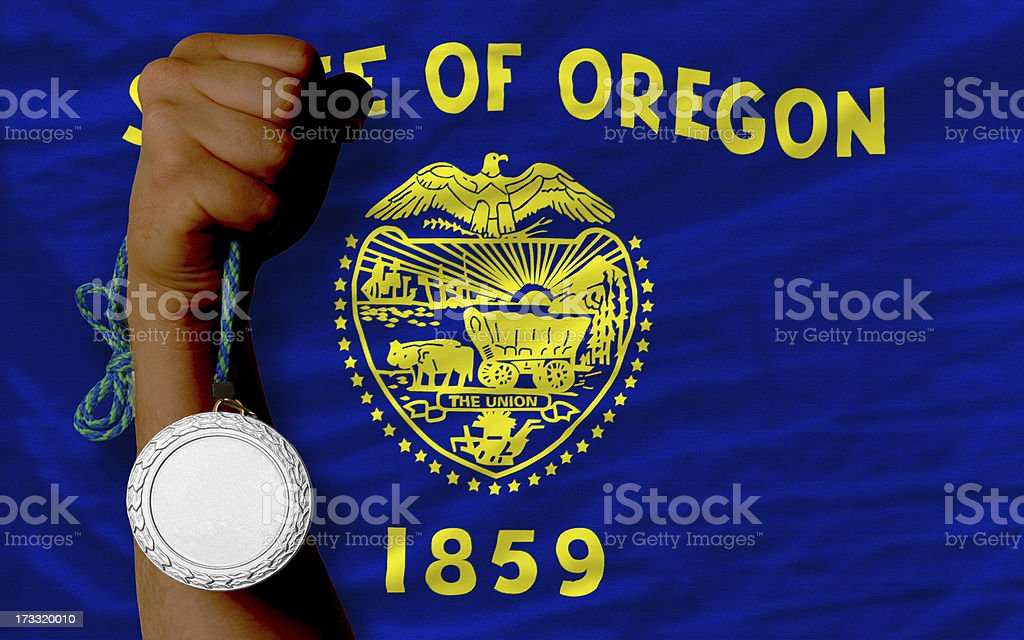 Silver medal for sport and  flag of oregon royalty-free stock photo