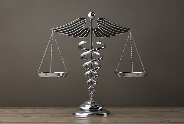 silver medical caduceus symbol as scales. 3d rendering - caduceus stock pictures, royalty-free photos & images