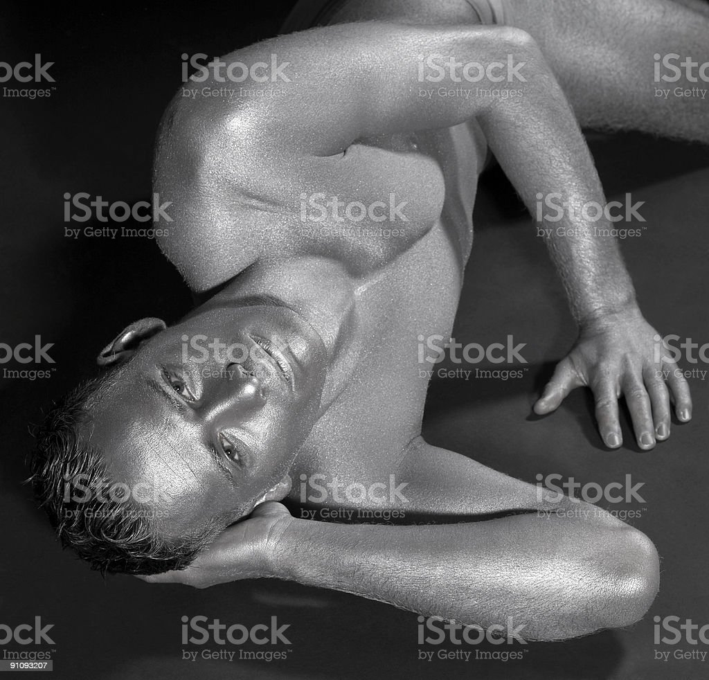 silver men resting on the ground stock photo
