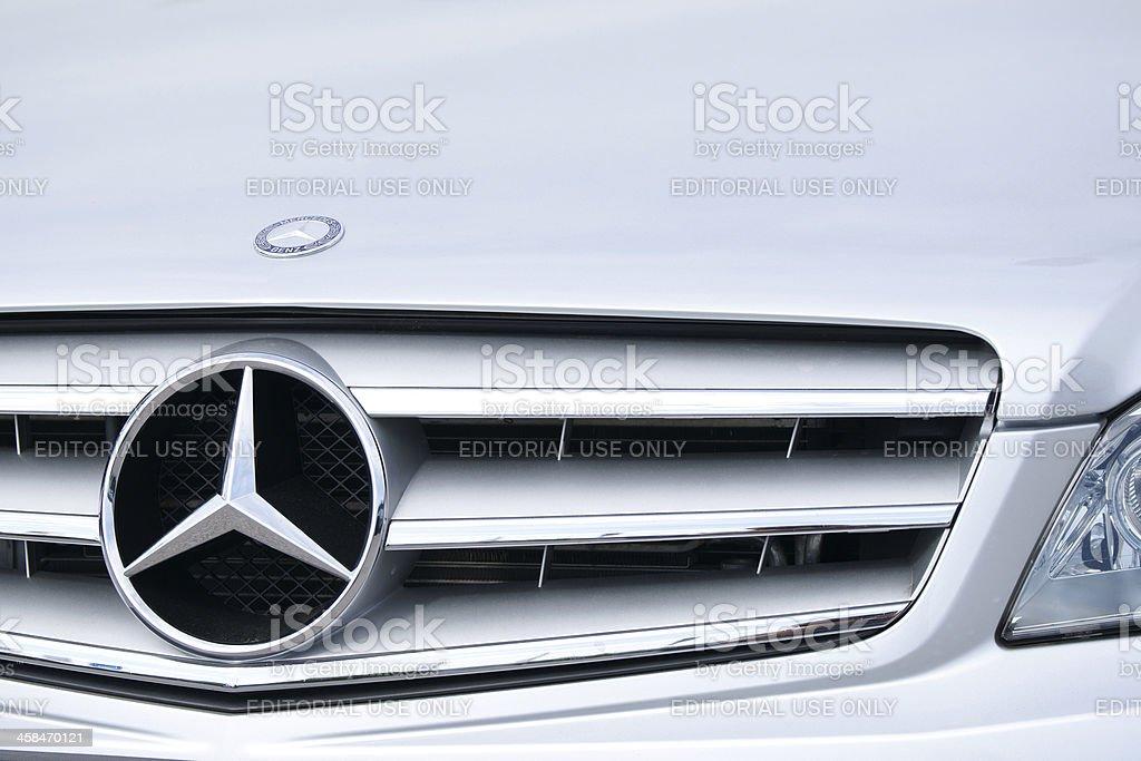 Silver Mercedes C-class car front closeup stock photo