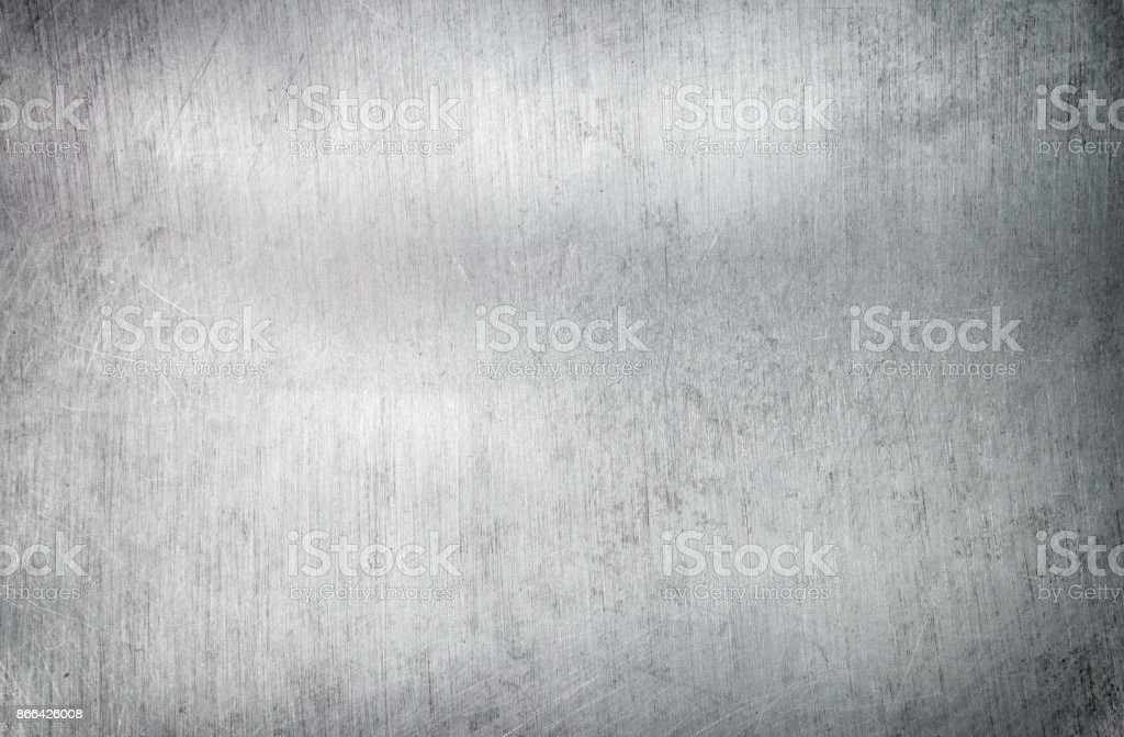 Silver metal background, steel sheet with a brush pattern stock photo