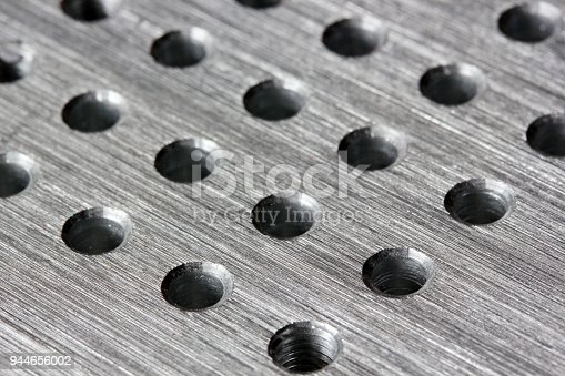 istock Silver metal background with round hole 944656002