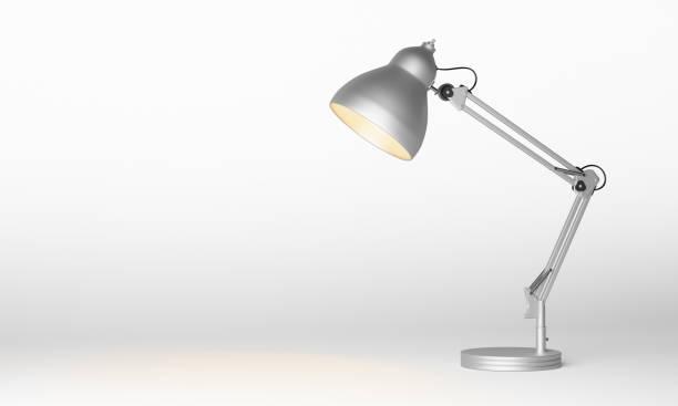 Silver metal desk lamp stock photo