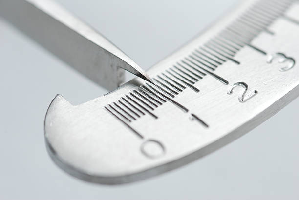 A silver metal measuring bar with metal pointer for accuracy stock photo