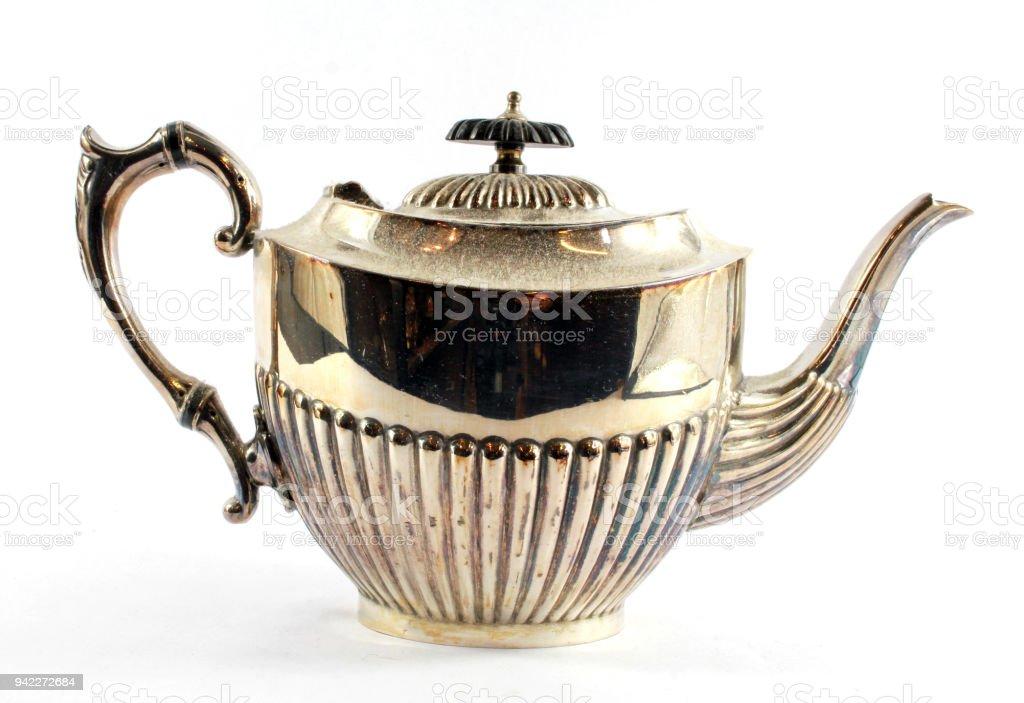 Silver Metal Ornate Tea Pot on White Background stock photo