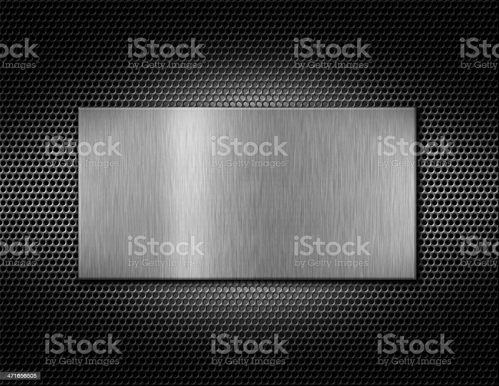 Silver metal plate on a grate royalty-free stock photo