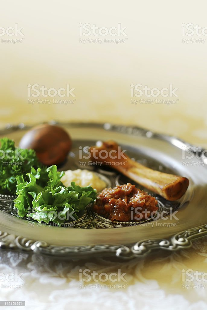 Silver metal plate with food from Passover Seder on cloth stock photo