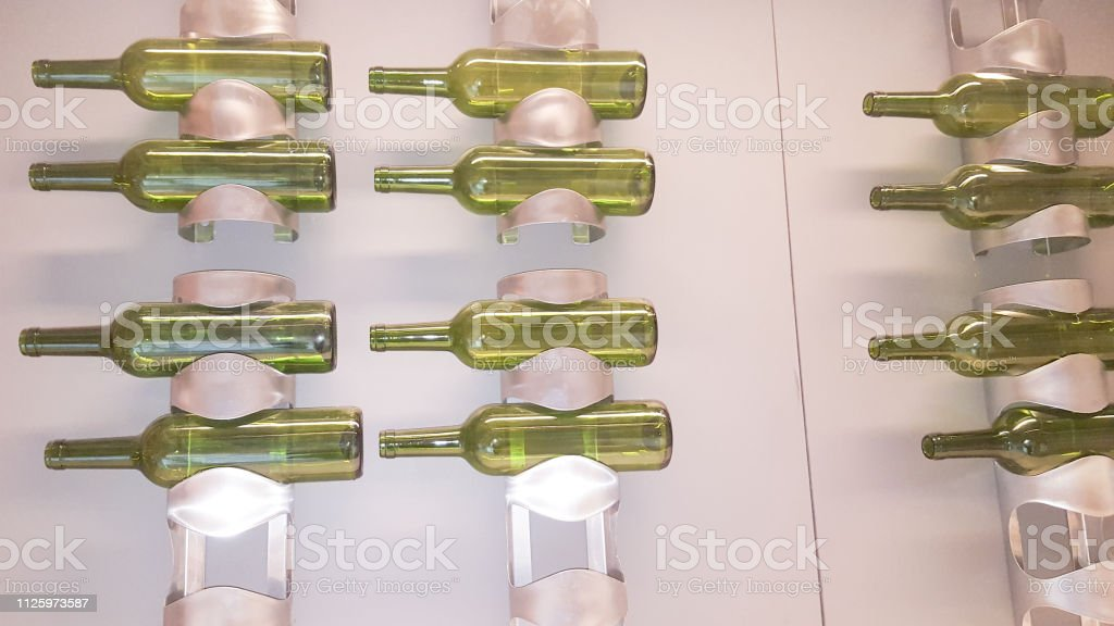 silver metal rack with green bottle in wall home