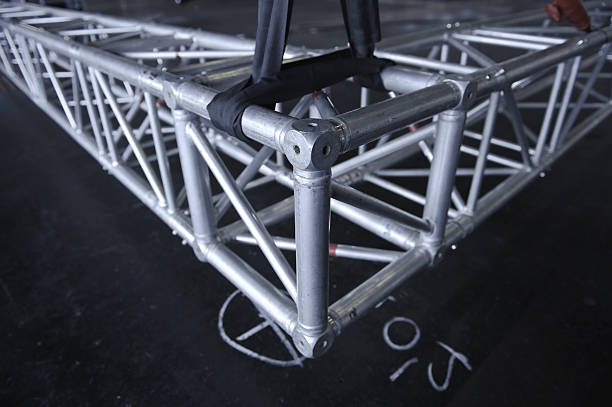 Silver metal rigging truss on a black floor Truss for speakers and light - shallow depth of field - Adobe RGB rigging stock pictures, royalty-free photos & images