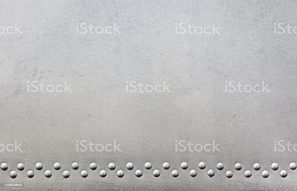 silver metal with rivets stock photo