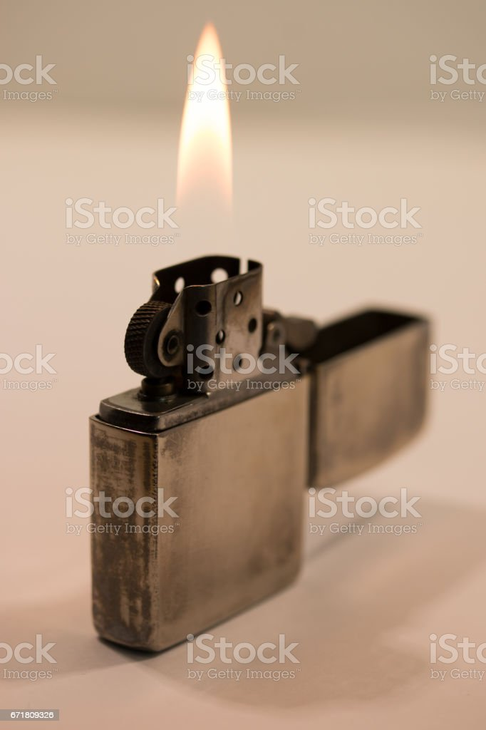 silver metal zippo lighter isolated on white stock photo