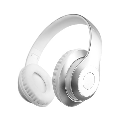 Silver metallic white wireless headphones in the air isolated on white background. Trendy minimal music device flying levitation concept of accessories. New technologies. Closeup high resolution