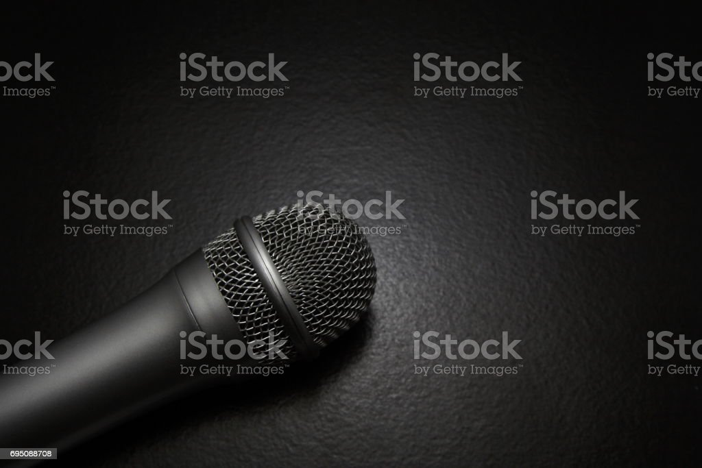 Silver Microphone in spot light stock photo