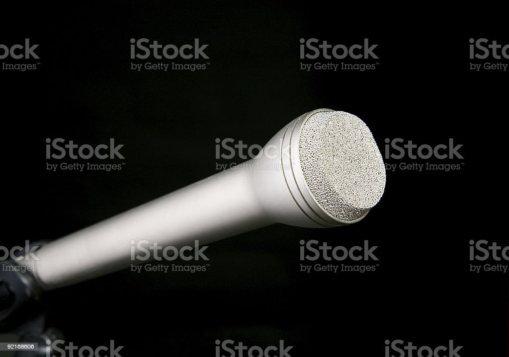Silver microphone on black stock photo