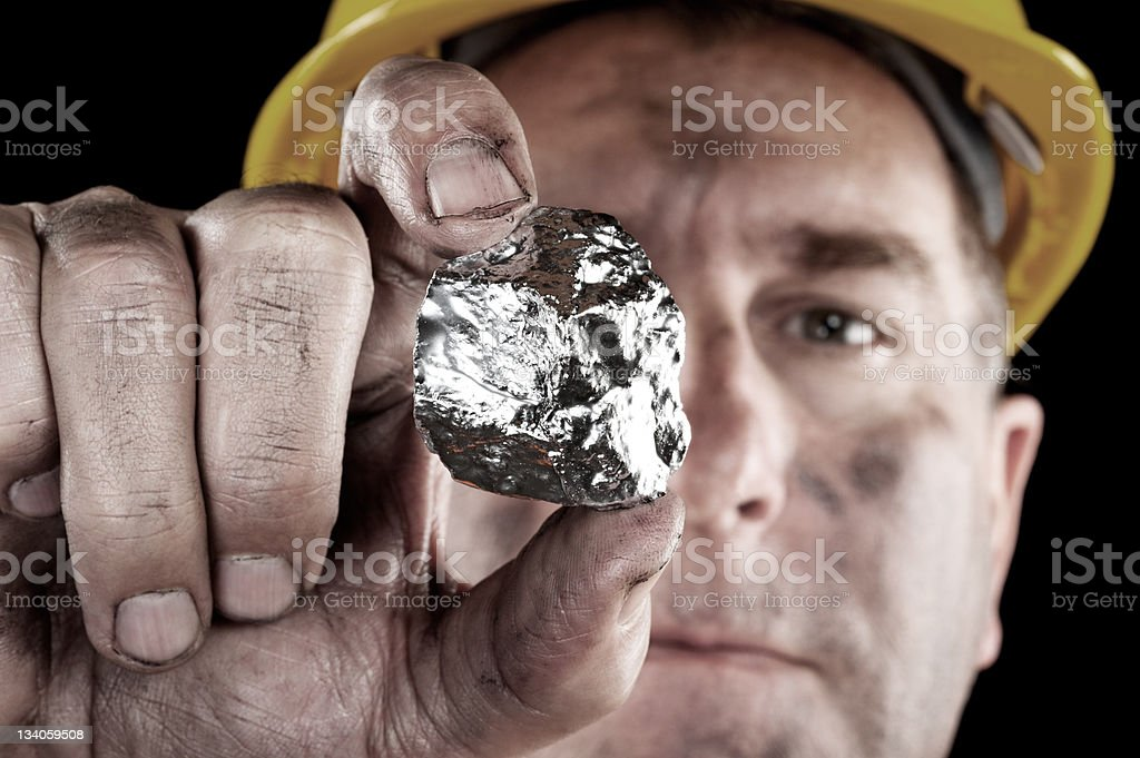 Silver miner with nugget stock photo