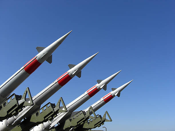 Silver Missiles In The Blue Sky Four missiles against clear blue sky. antiaircraft stock pictures, royalty-free photos & images
