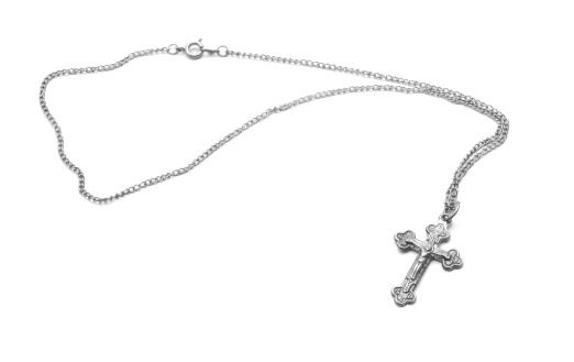 silver necklace with cross isolated on white