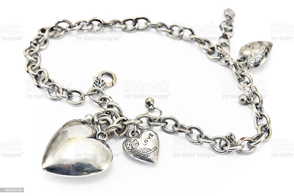 Silver necklace  with heart pendants stock photo