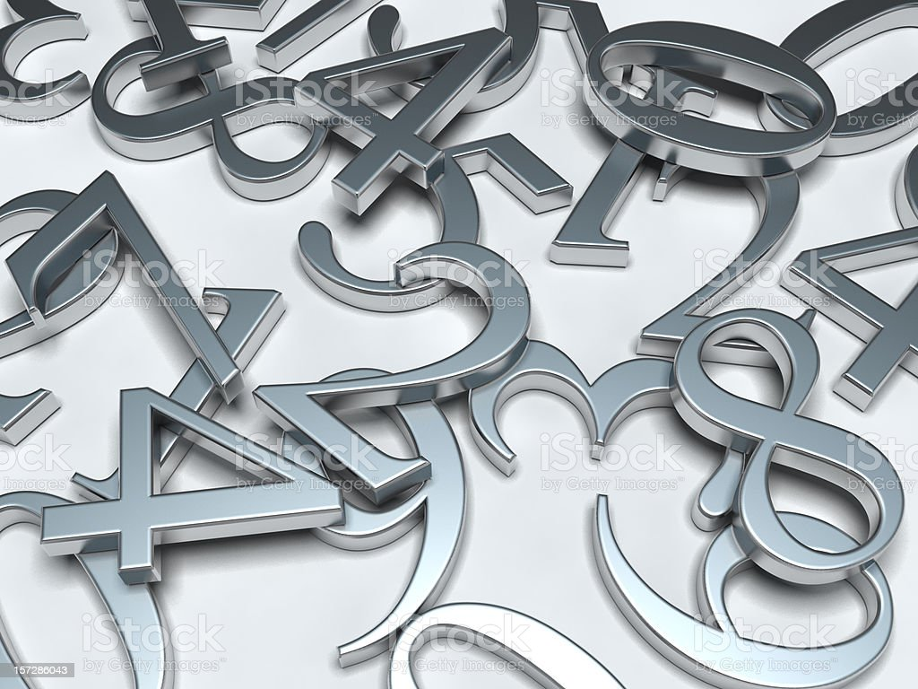 Silver numbers strewn on a white background royalty-free stock photo